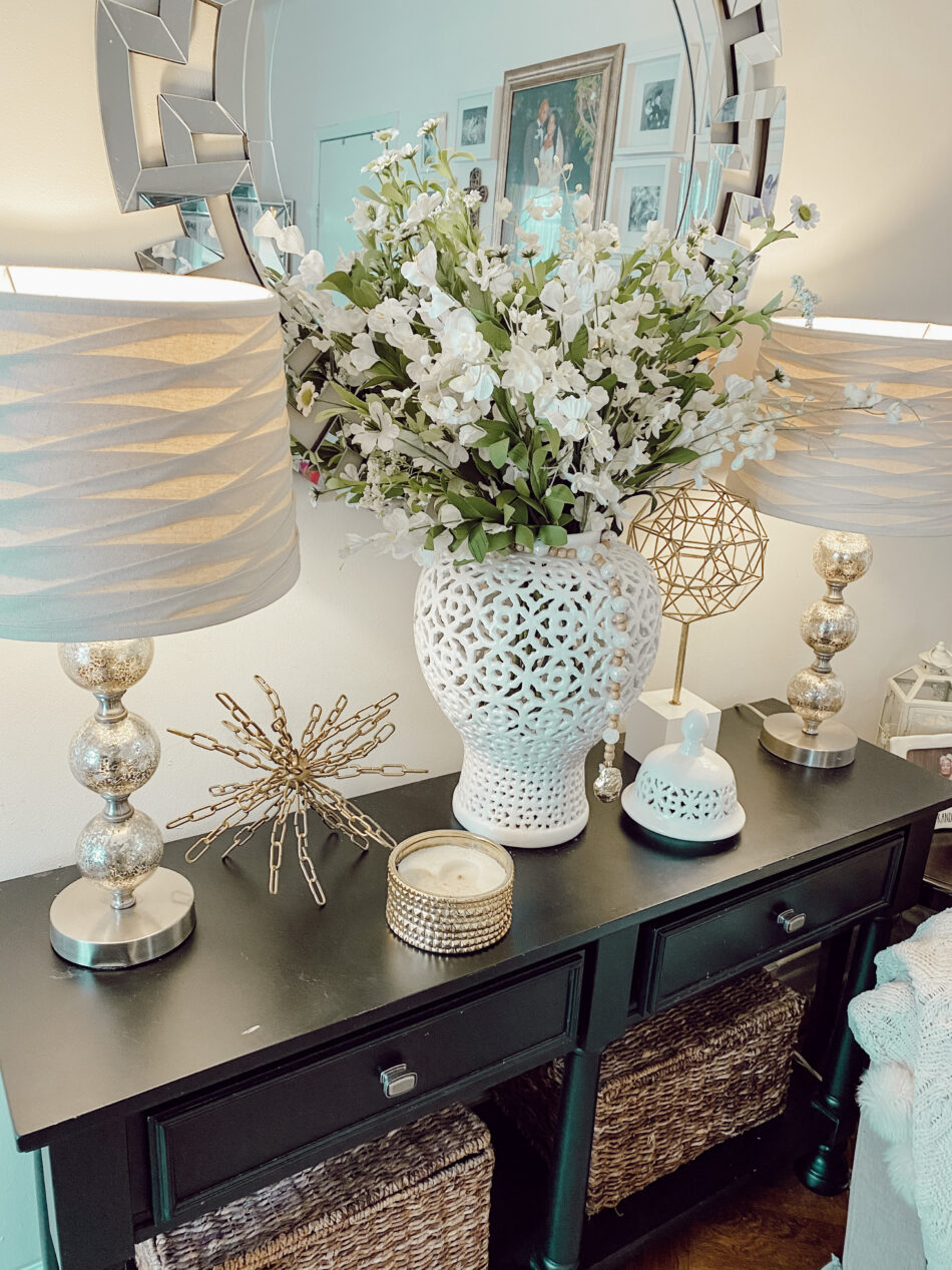 Decorate a console table.
